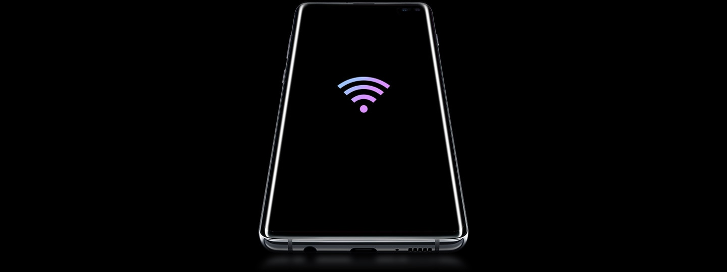 Galaxy S10 plus laying on its back, seen at a slight angle from below, with a prismatic Wi-Fi icon on screen.