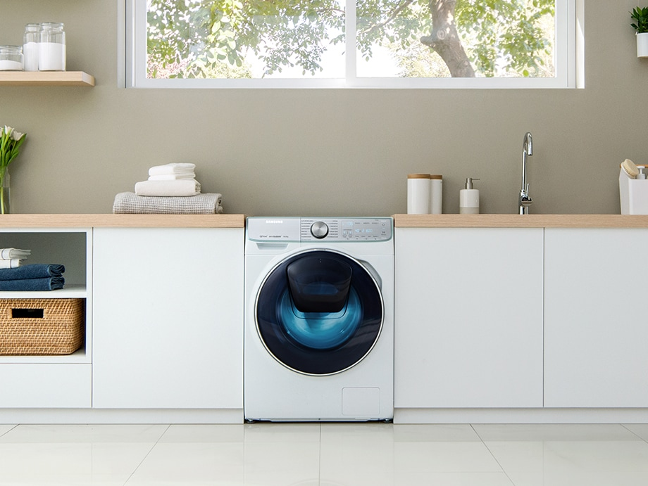 The QuickDrive™ washing machine is perfectly built into a laundry room. The washing machine looks sleek and refined, running smoothly and quietly.
