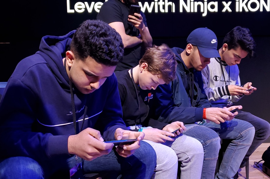 Four gamers of various ages battle on their Samsung Galaxy mobile gaming devices at Samsung 837