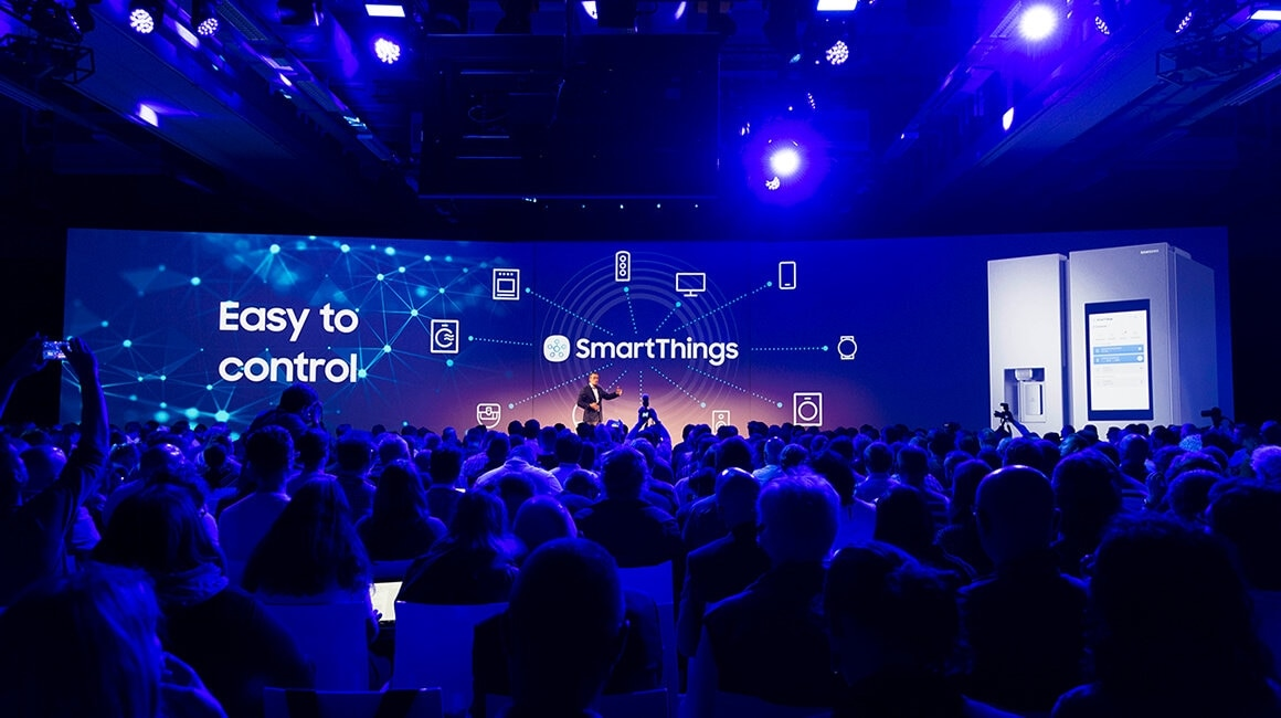 Daniel Harvie, Vice President & Head of Home Appliances, Samsung Europe, demonstrates how Samsung's Family Hub refrigerator seamlessly connects with SmartThings-compatible appliances.