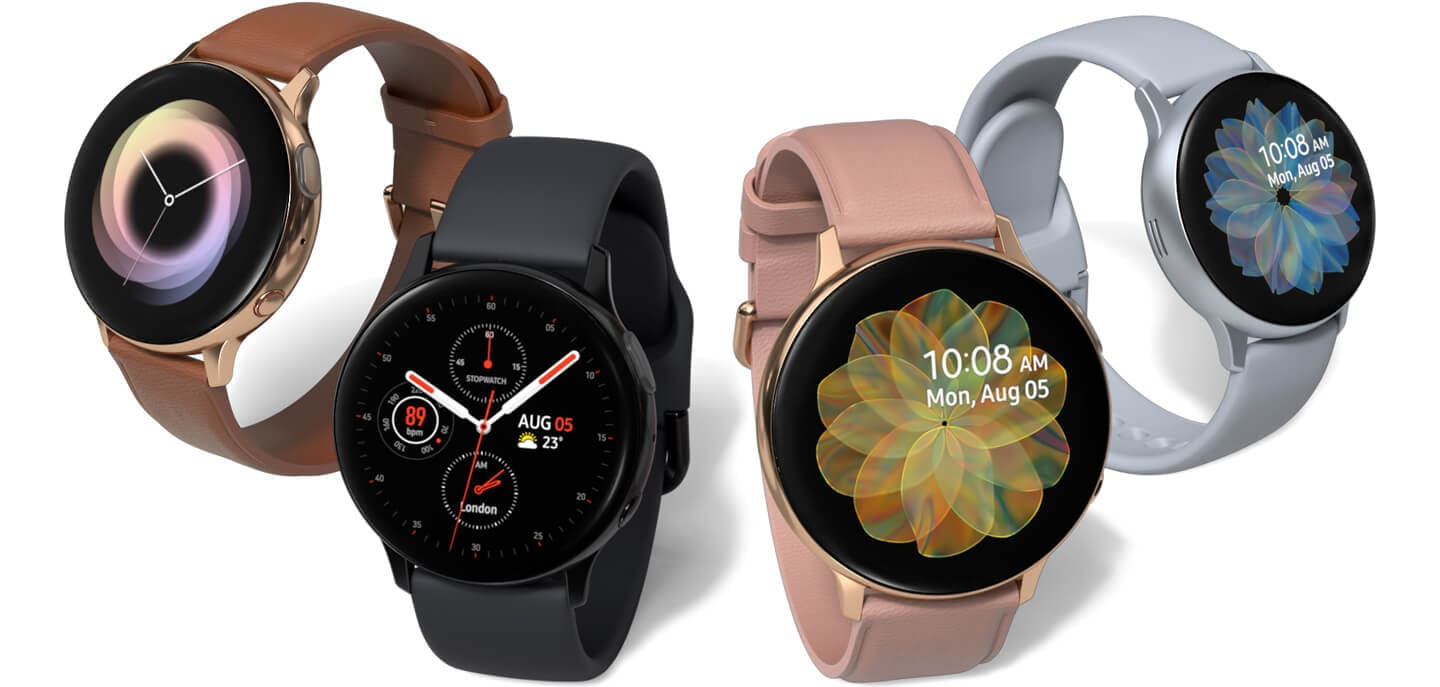 Four Galaxy Watch active2 models side by side in a range of colors and materials: gold watch case with brown leather strap, black watch case with aqua black sport band, gold watch case with pink leather strap, and Cloud silver watch case with cloud silver sport band.