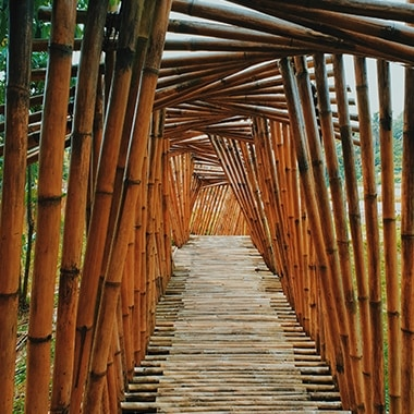 A photo captured with Galaxy by Instagram user @adiheikal looking down a walkway made of bamboo