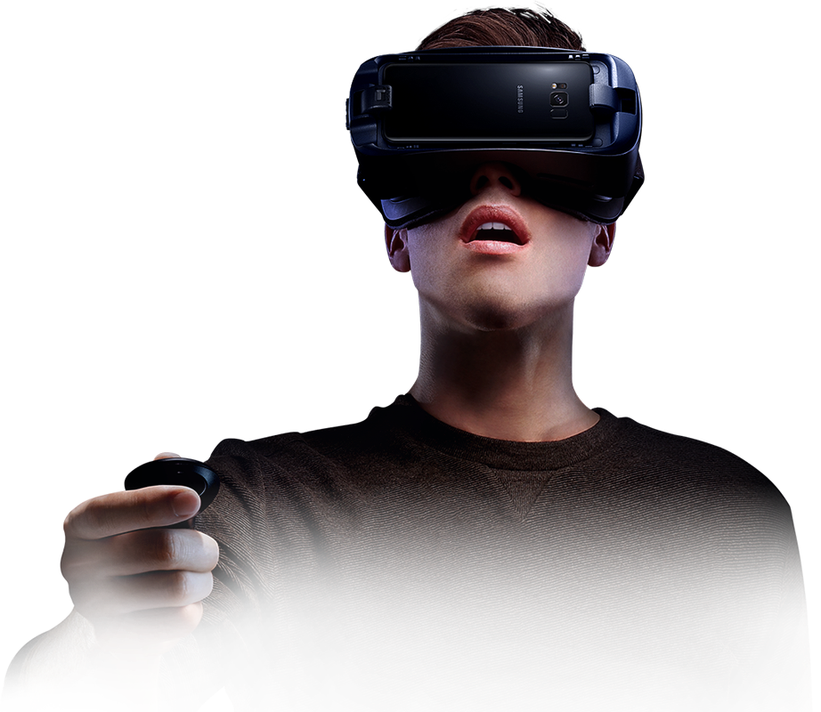 Person immersed in virtual reality wearing the Gear VR and holding the controller