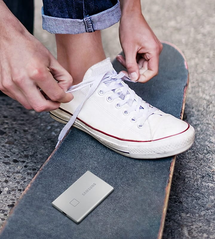 A lifestyle image of Portable SSD T7 Touch placed on the skateboard.