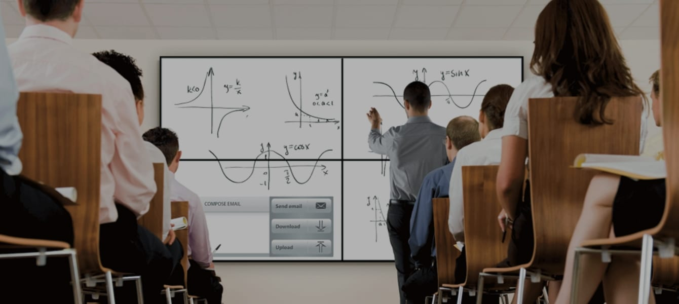 A teacher drawing graphs on Samsung E-Boards in a lecture