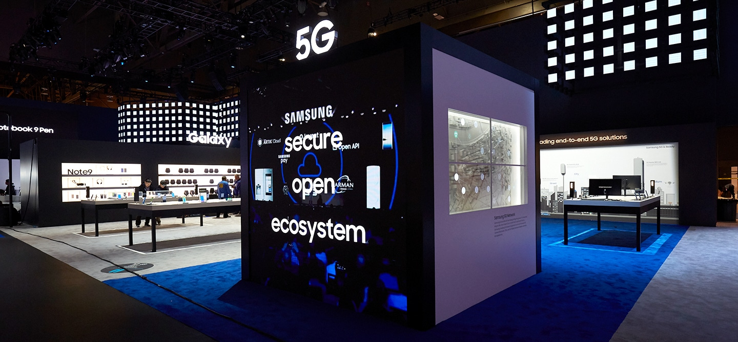 Attendees explore the possibilities of 5G integration at the 5G zone inside the Samsung booth at CES 2019.  The 5G monument display provides attendees with an opportunity to learn more about 5G.
