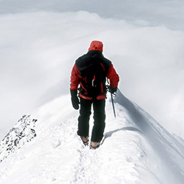 Man at the top of a snowy peak