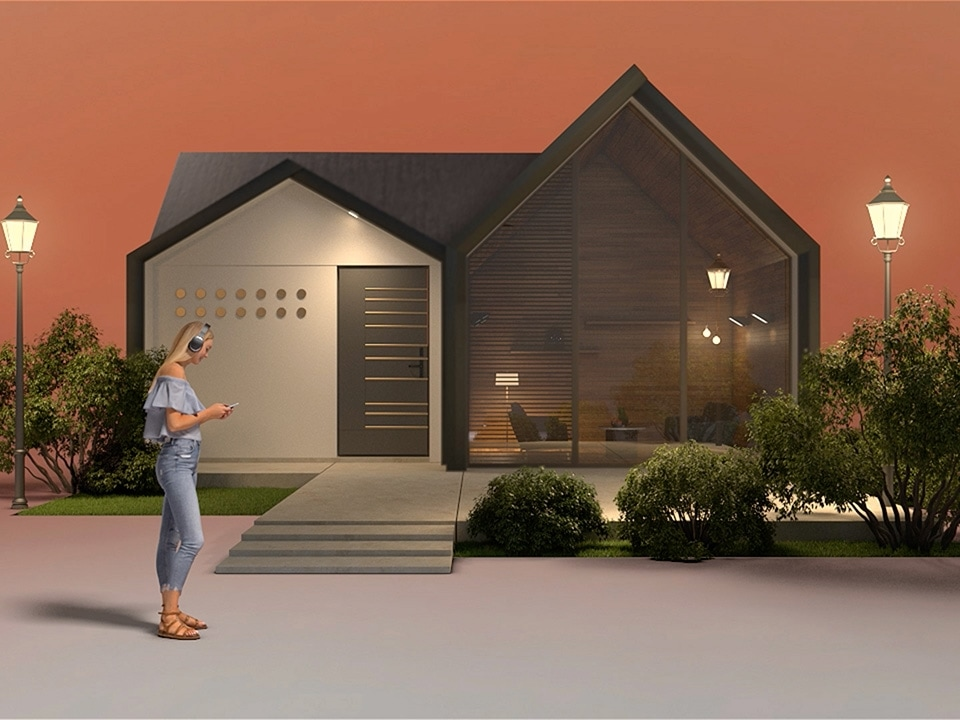 The woman listening to music on her phone as she goes into her house.