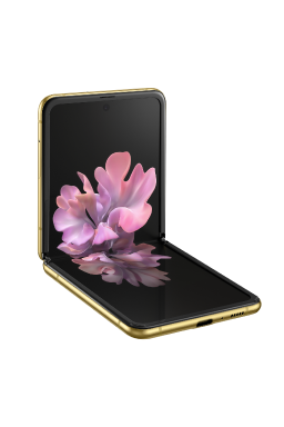 Galaxy Z Flip in Mirror Gold folded to a right angle, seen from the front with the blossoming flower graphic wallpaper onscreen