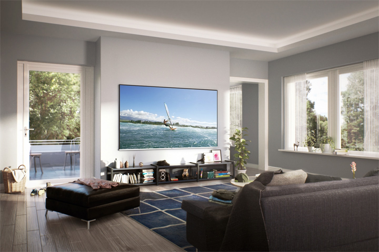 Wide view of cozy living room with daylight from out of the window. A Super Big TV is hung on the wall. On the screen, a man is enjoying surfing.
