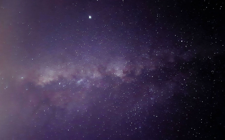 Some night sky photography showing the Milky Way stretching horizontally across the night sky.