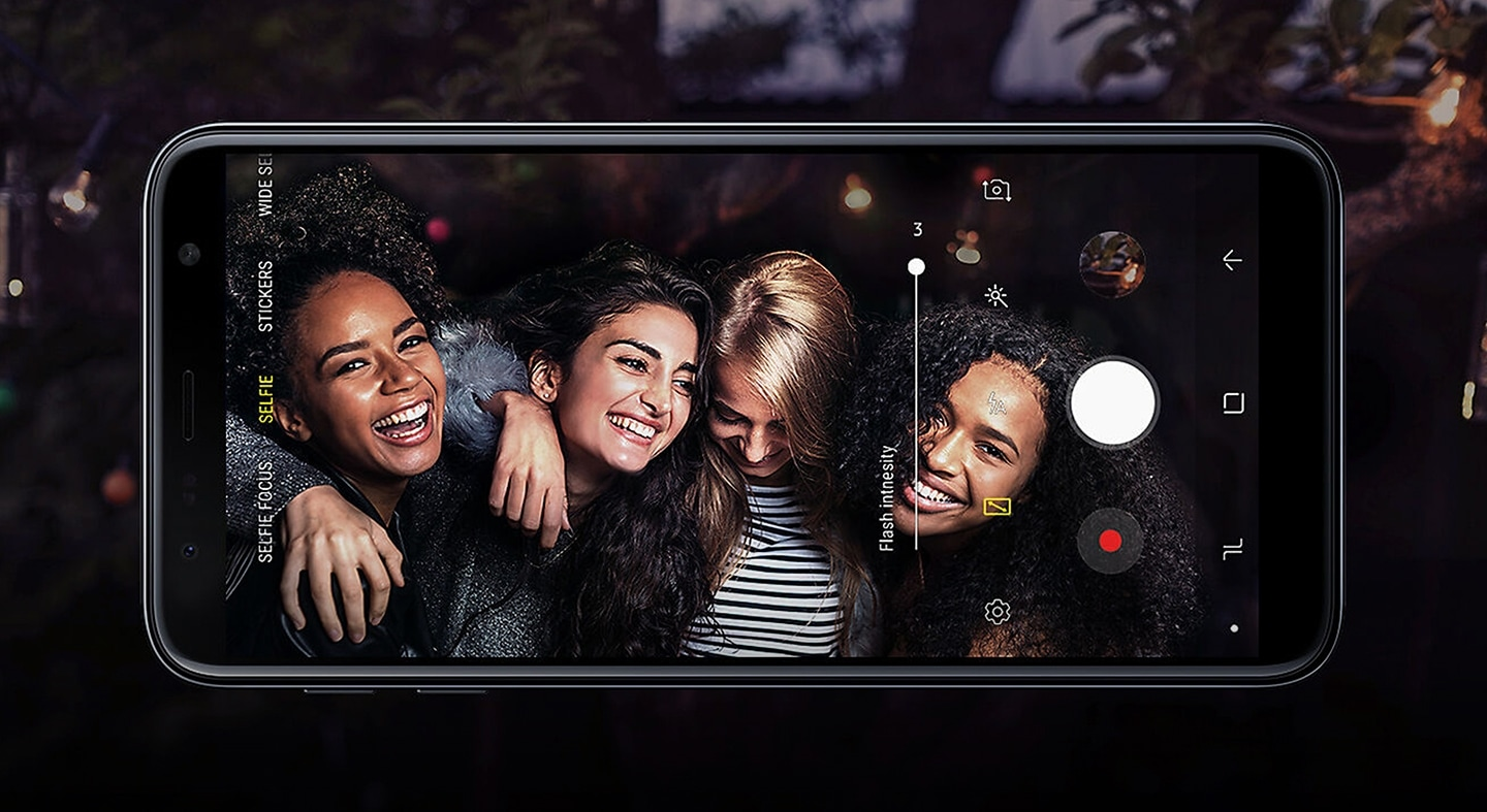 Closeup of four women smiling in a photo on a Samsung Galaxy phone
