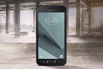 Samsung Galaxy XCover 4s with industrial warehouse in background