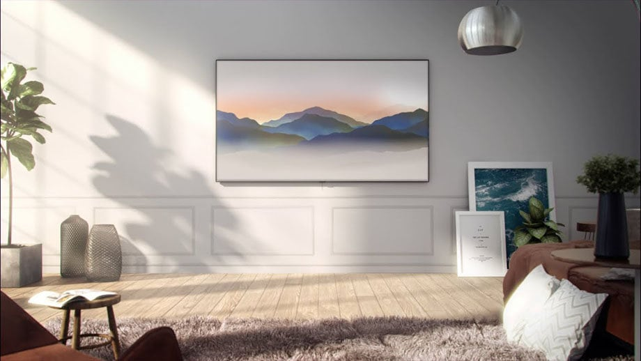 QLED TV is hung on the wall with its Ambient Mode on.