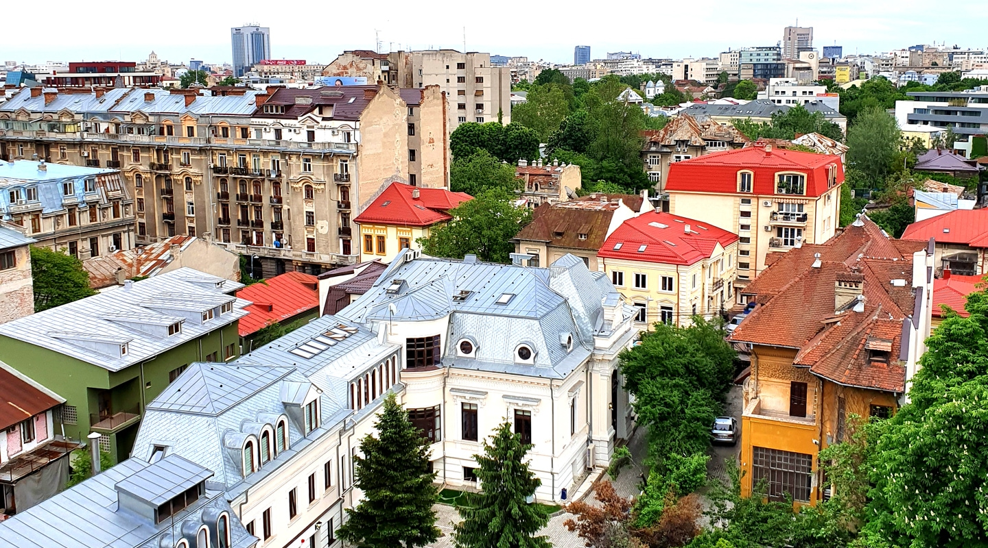 Panoramic view of rooftops in Bucharest, the capital of Romania. Picture taken with Samsung Galaxy S10 shows arresting architecture and colorful houses.
