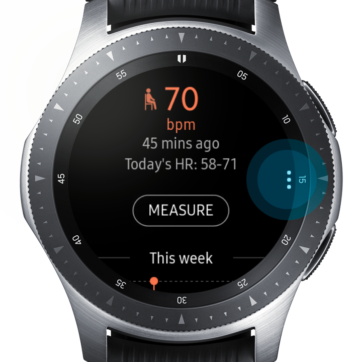 Image of the Galaxy Watch displaying the Heart Rate Monitoring app with the Settings icon (three vertical dots) highlighted at the 3 o'clock position on the watch face