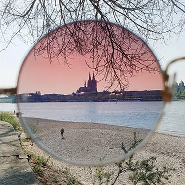A photo captured with Galaxy by Instagram user @lulovas of a landscape seen through a rose-colored sunglass lens