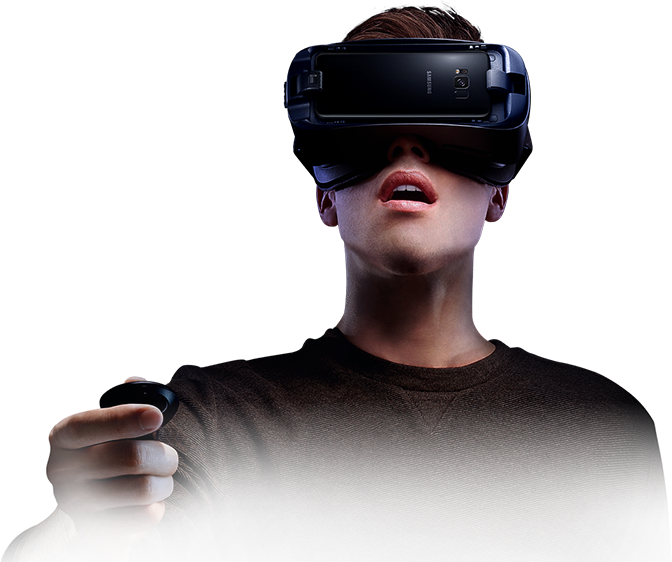 606c097f6de2 Person immersed in virtual reality wearing the Gear VR and holding the  controller