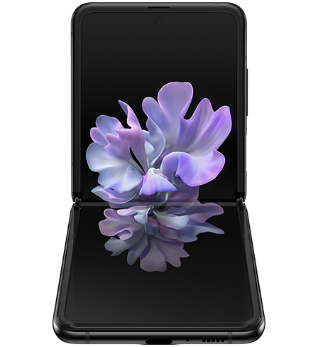 Galaxy Z Flip in Mirror Black folded to a right angle, seen from the front with the blossoming flower graphic wallpaper onscreen