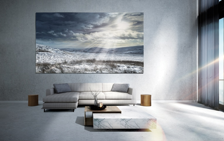 The Wall display in a bright, modern living room with a view of a serene landscape.