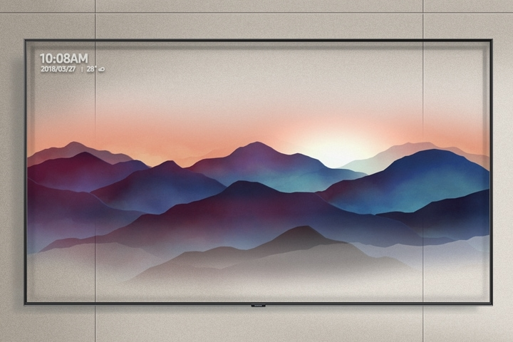 Super Big TV hung on a grey-toned wall is showing décor mode of the Ambient Mode. The semi-transparent image of mountains is well harmonized with the color and texture of the wall.