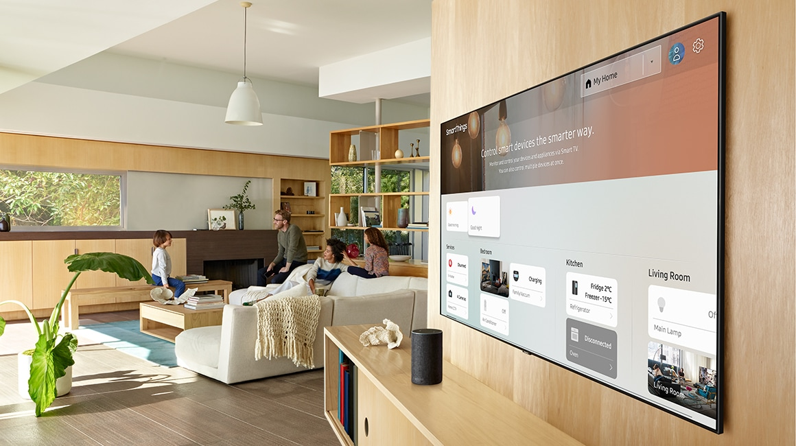 A lifestyle image of the 2019 new Samsung QLED Q70R. Image shows Q70R mounted on wooden wall with SmartThings dashboard on the TV screen.