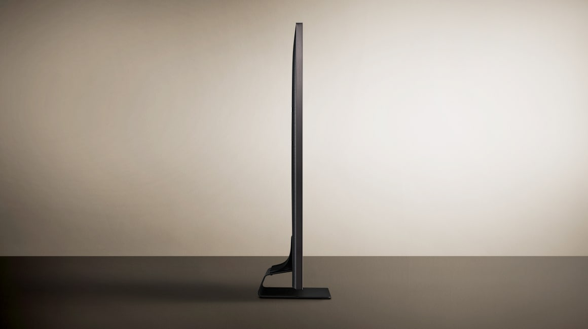 A side view of the 2019 new Samsung QLED Q90R. Image shows the thin bezel and bending plate stand design of Q90R.