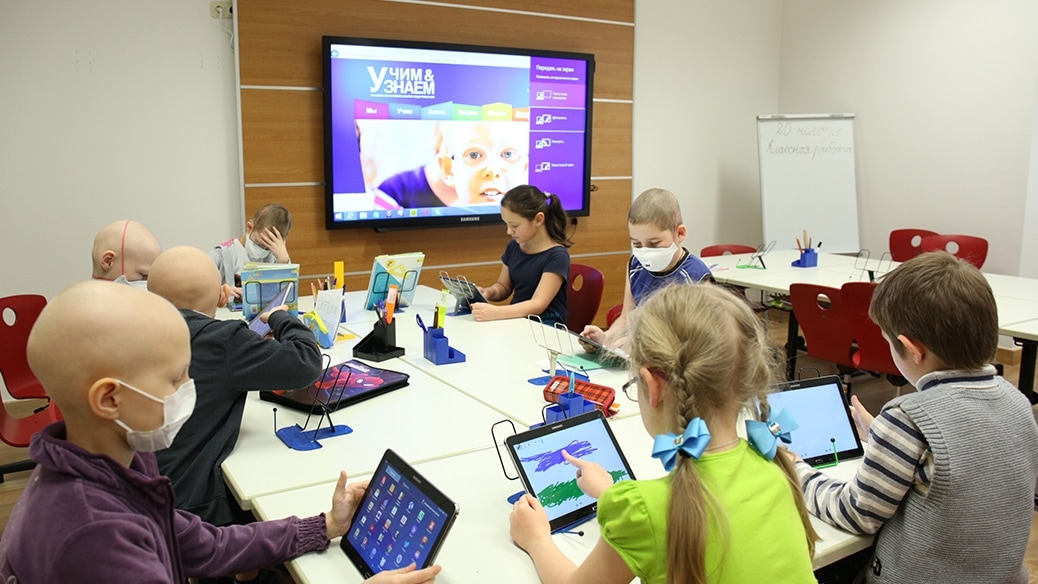 This is a picture of students studying using tablets.