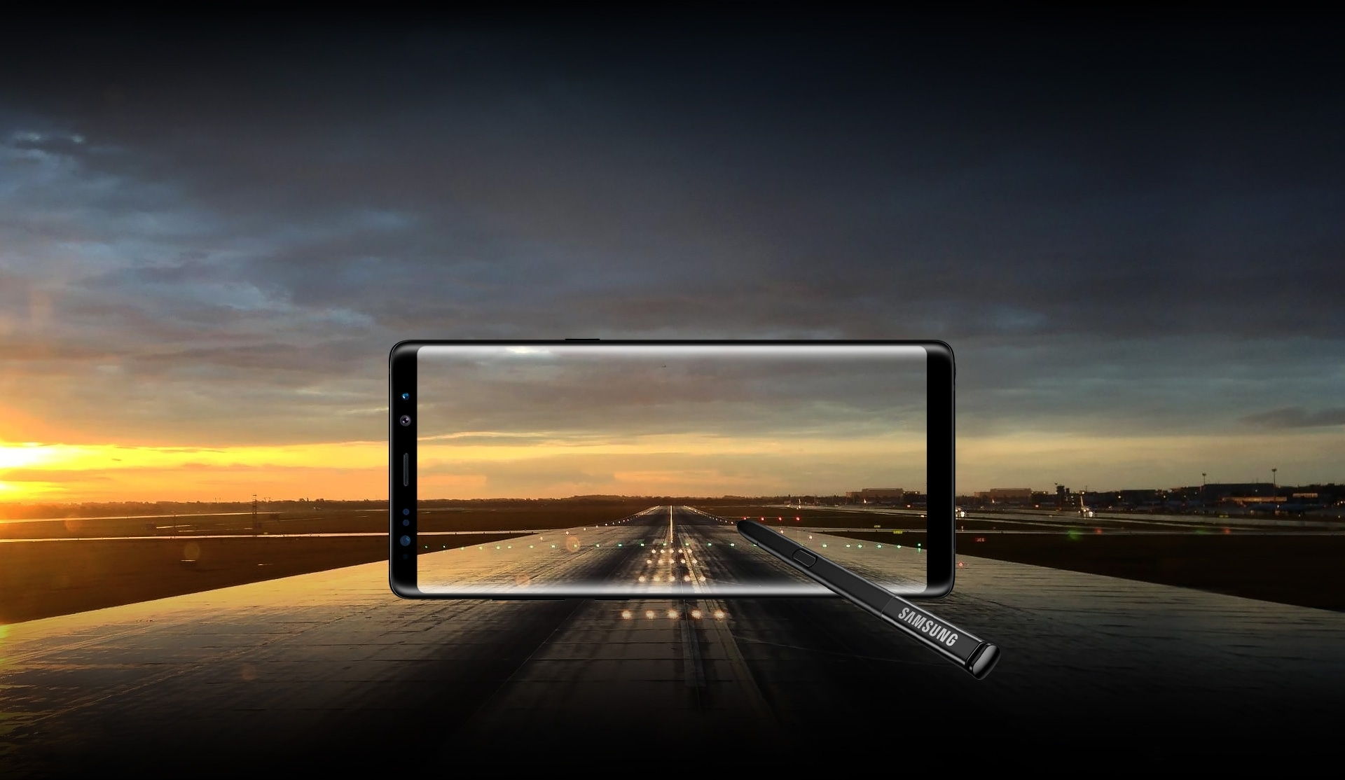 Image of translucent Galaxy Note8 and the S Pen over an airport runway