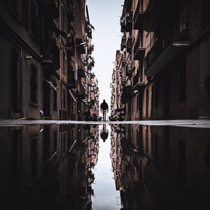The streets of Barcelona reflected in puddles