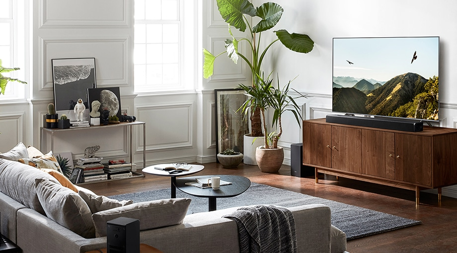 In modern living room, QLED TV is put on the TV unit along with a soundbar. QLED TV is the top holiday gift for who want to find high resolution tv.