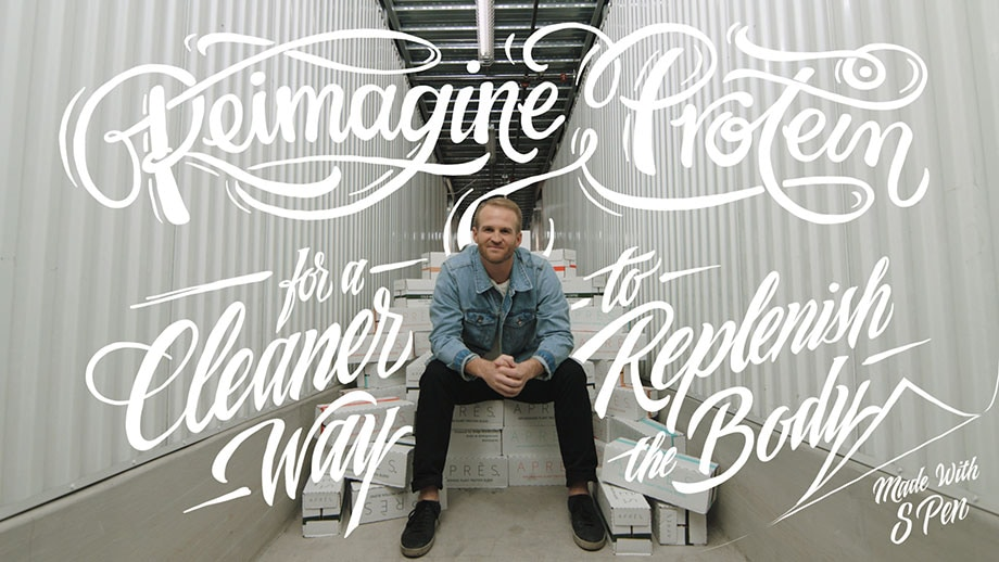 "The Co-Founder and CEO of Après, Sonny McCraken sits on a pile of boxes containing his product. There is handwritten script overlayed on top of the photo that reads: ""Reimagine protein for a cleaner way to replenish the body. Made with S Pen""."