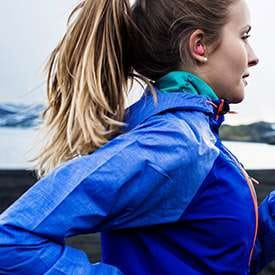 Thumbnail of person wearing Gear IconX while running outside