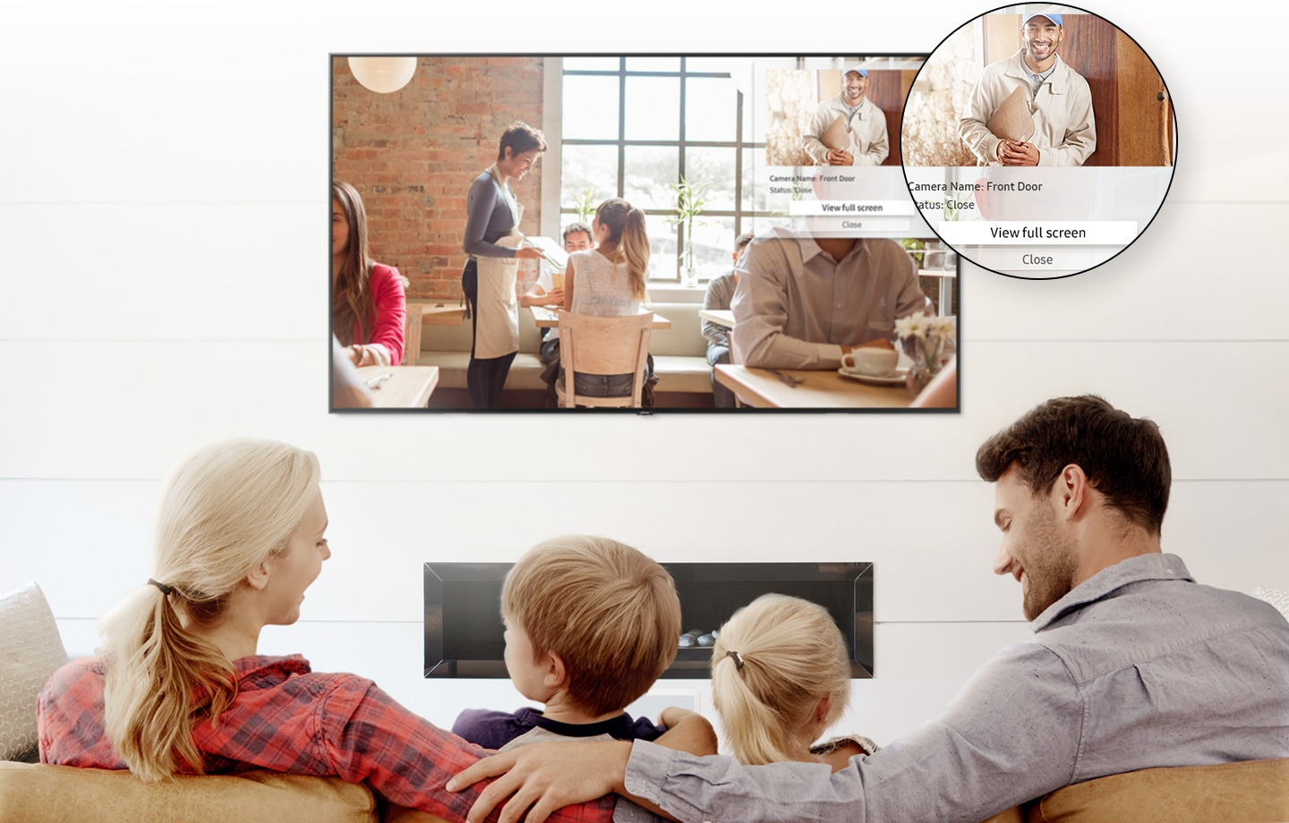 4 people are watching Smart TV with a pop-up alarm showing who's ring the doorbell.