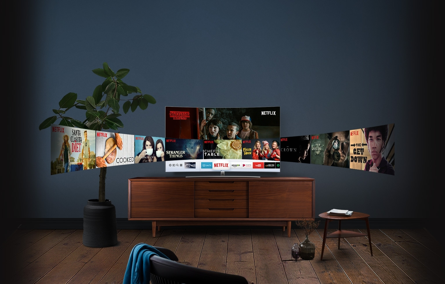 Curved screen QLED TV is placed on the wooden shelf, and various NETFLIX contents on the screen are displayed like a panorama on the screen.