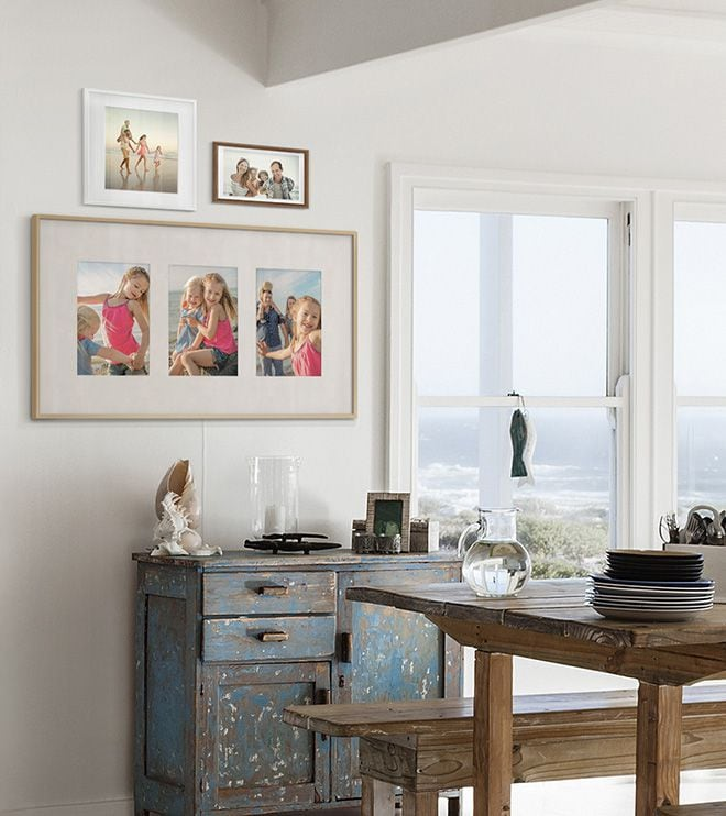 The Frame displaying three photographs in Triptych layout with antique matte colour, hanging on the wall in dining room.
