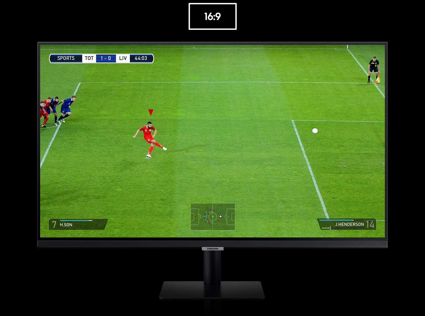 The monitor shows a photo of a penalty kick in a soccer match. As the 16:9 ratio display transforms to 21:9, the goalkeeper on the right and other players behind the kicker on the left are revealed. The additional view on each side highlighted by dotted lines.