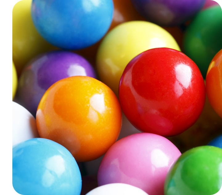 A close-up taken with the Macro Camera, showing the details of a group of small colorful spheres.