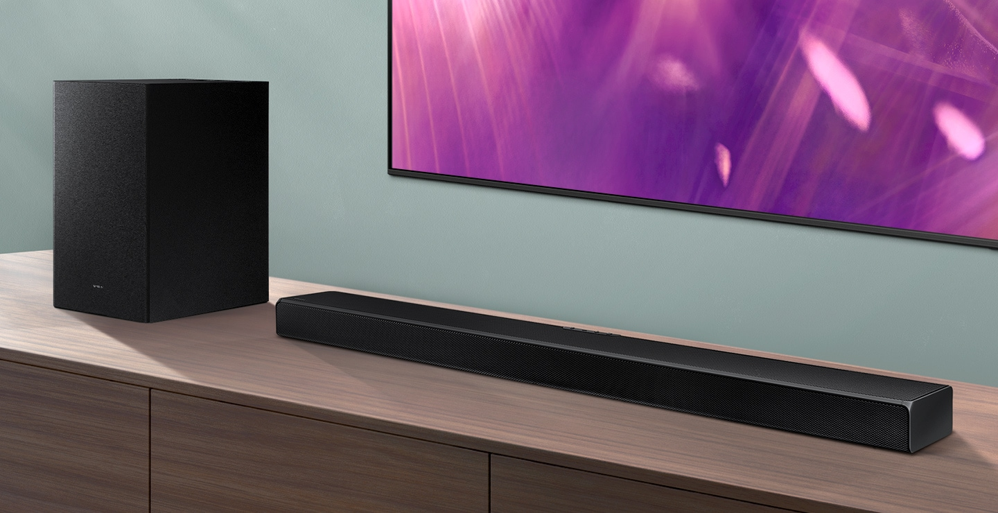 A series Soundbar and subwoofer are positioned next to Crystal UHD TV.