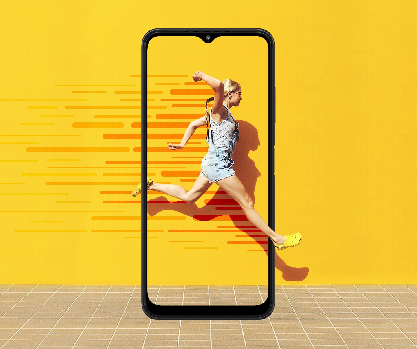 The Galaxy A22 5G is used as a frame in the foreground. Onscreen, a woman leaps foward in front of a yellow wall with dark orange illustrative lines to demonstrate movement trailing behind her. Her movement expands beyond the phone's display.