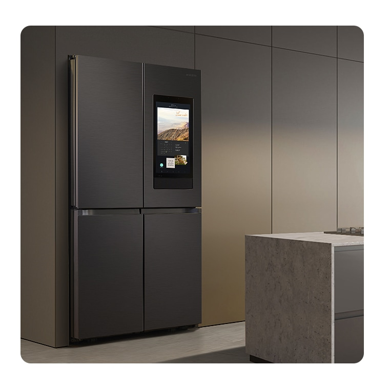The sleek exterior of the fridge gives a clean look to the modern kitchen, with a flat finish and no recessed handles.