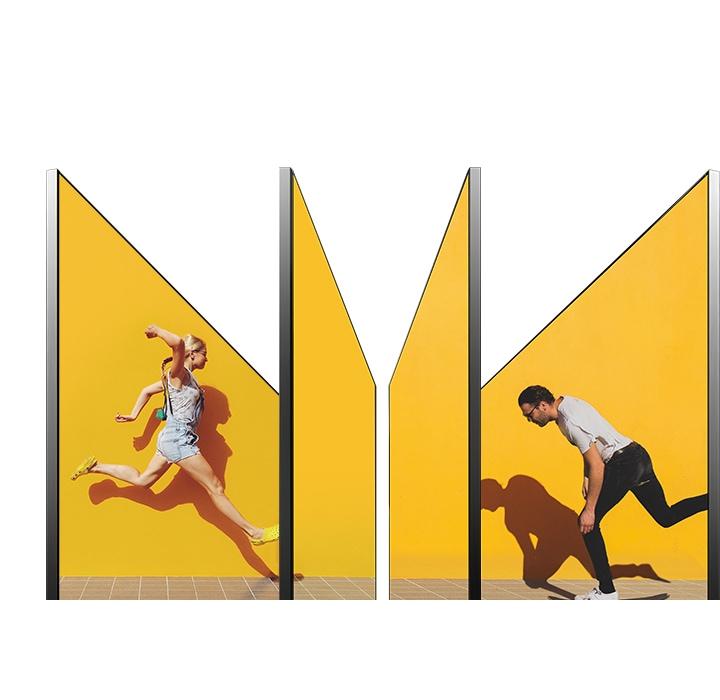 Čtyři televizní obrazovky jsou uspořádány do různých úhlů, takže jednu lze vidět ze strany, a pár běžící je vidět na čtyřech televizních obrazovkách jako jedna obrazovka.