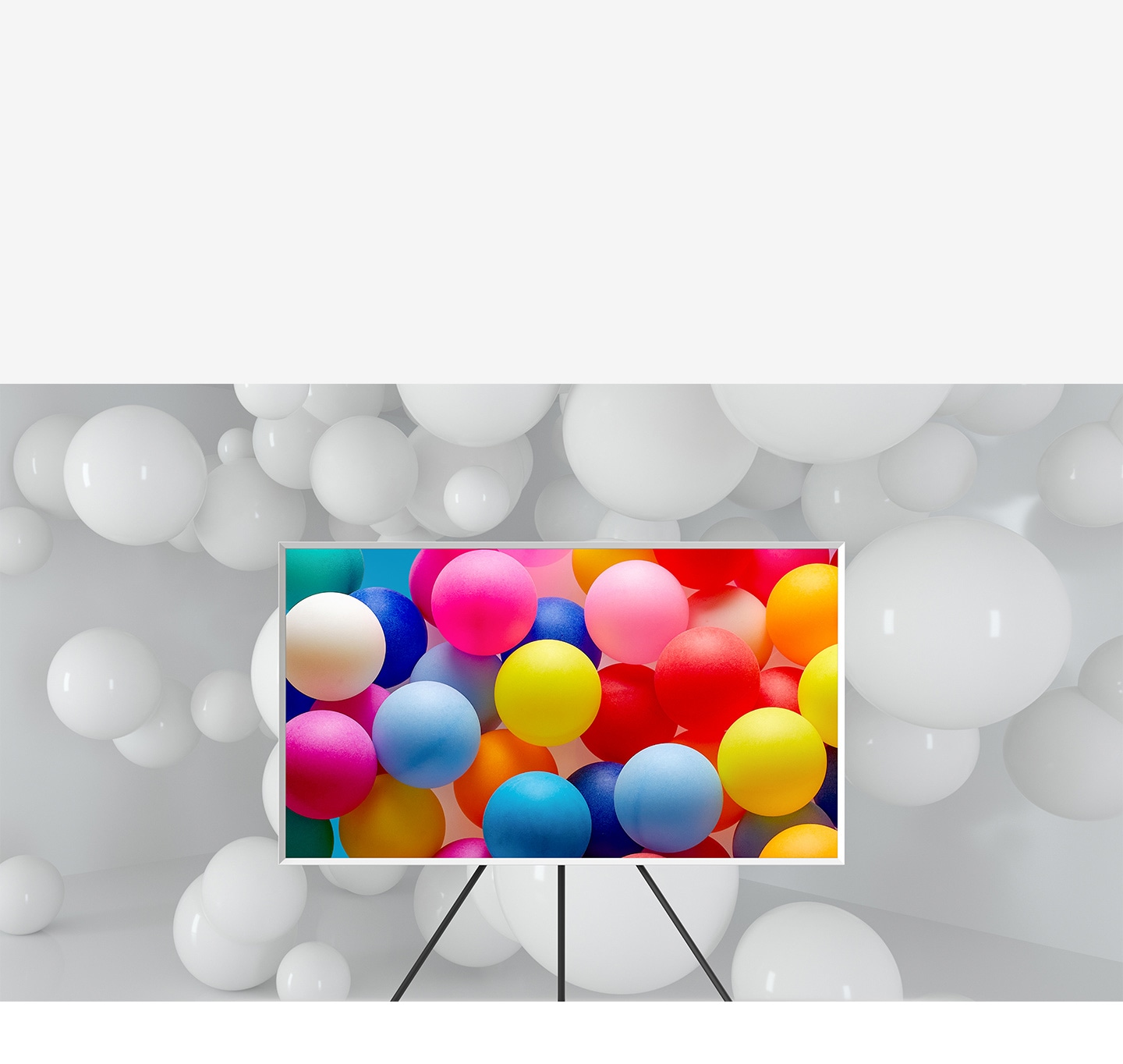 The Frame which is on Studio Stand is in a room full of white balloons. Only the balloons on the screen are visible in various vivid colors.