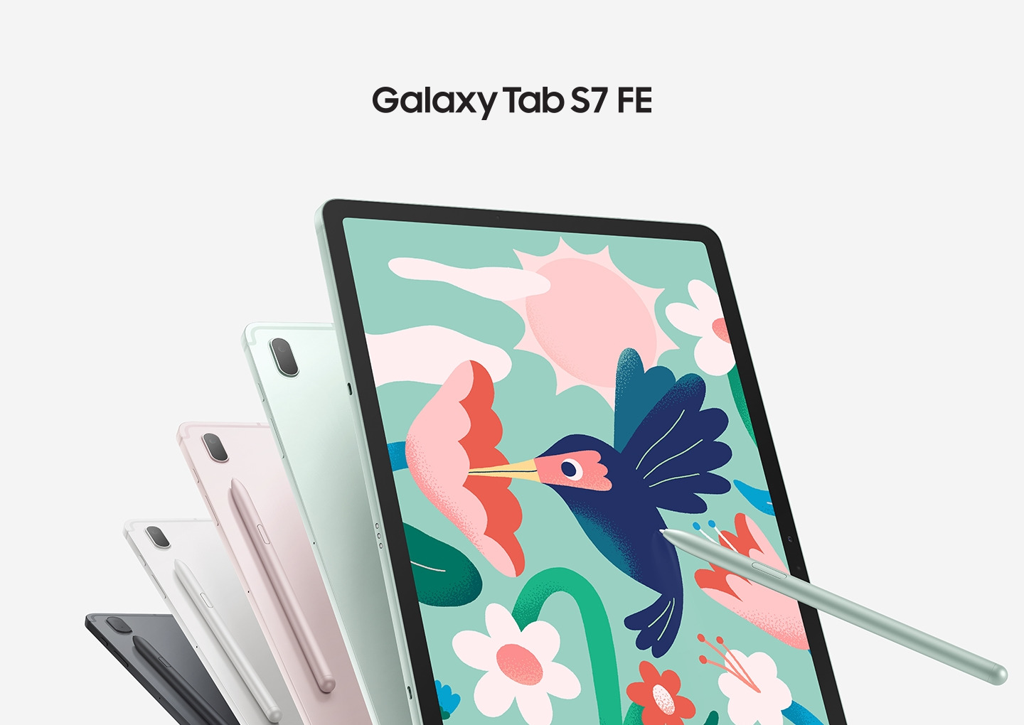 Five Galaxy Tab S7 FE tablets, four seen from the rear and one seen from the front. The ones seen from the rear show the colors Mystic Black, Mystic Silver, Mystic Pink and Mystic Green, and the matching S Pen is magnetically attached on the back. The tablet seen from the front has the S Pen touching the screen as it draws a hummingbird sipping from a flower. Text says Galaxy Tab S7 FE