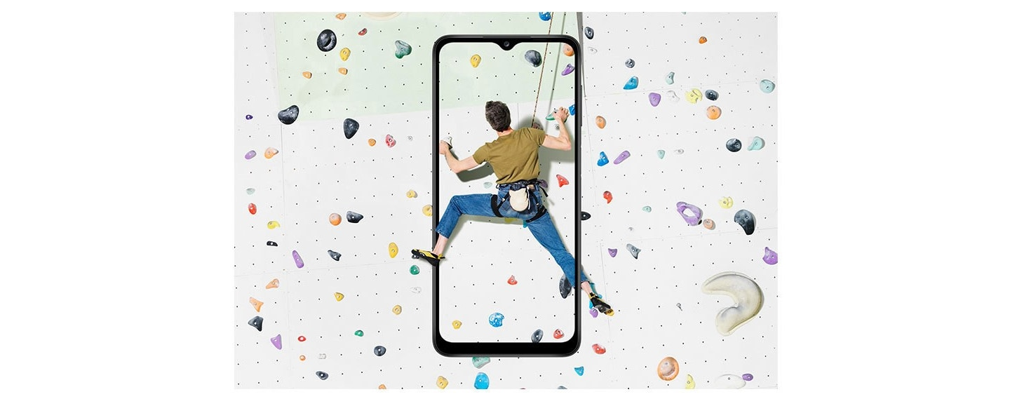 A guy climbing in motion captured in Galaxy A12 display, utilizing 6.5 inch Infinity-V display feature.