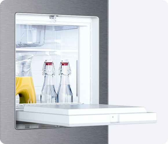 Beverage Station is open with bottles of water and juice, indicating it offers easy access to neatly stored drinks.