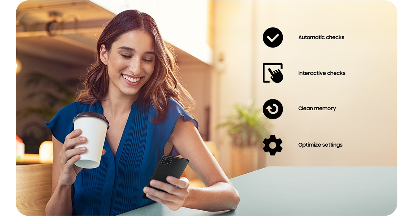 A woman holding a coffee cup and using her Galaxy A22 5G. A checkmark icon for Automatic Checks, an icon of a hand tapping a screen for Interactive checks, an icon of arrow going in a circle for Clean memory and a cog icon for Optimize settings.