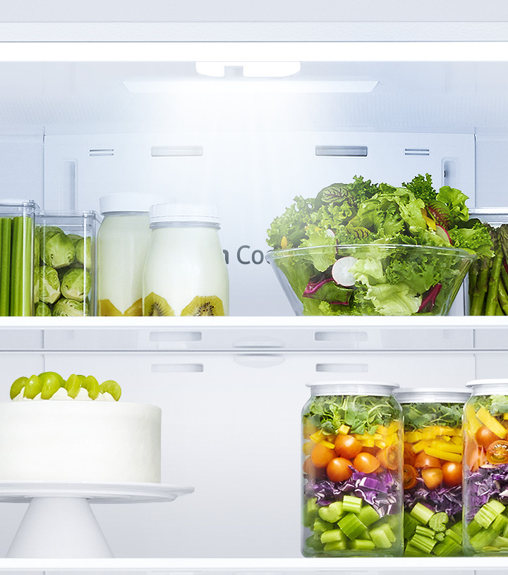 All the doors of the RF5000A are open, while LED lighting illuminates the food in the fridge and freezer chambers.