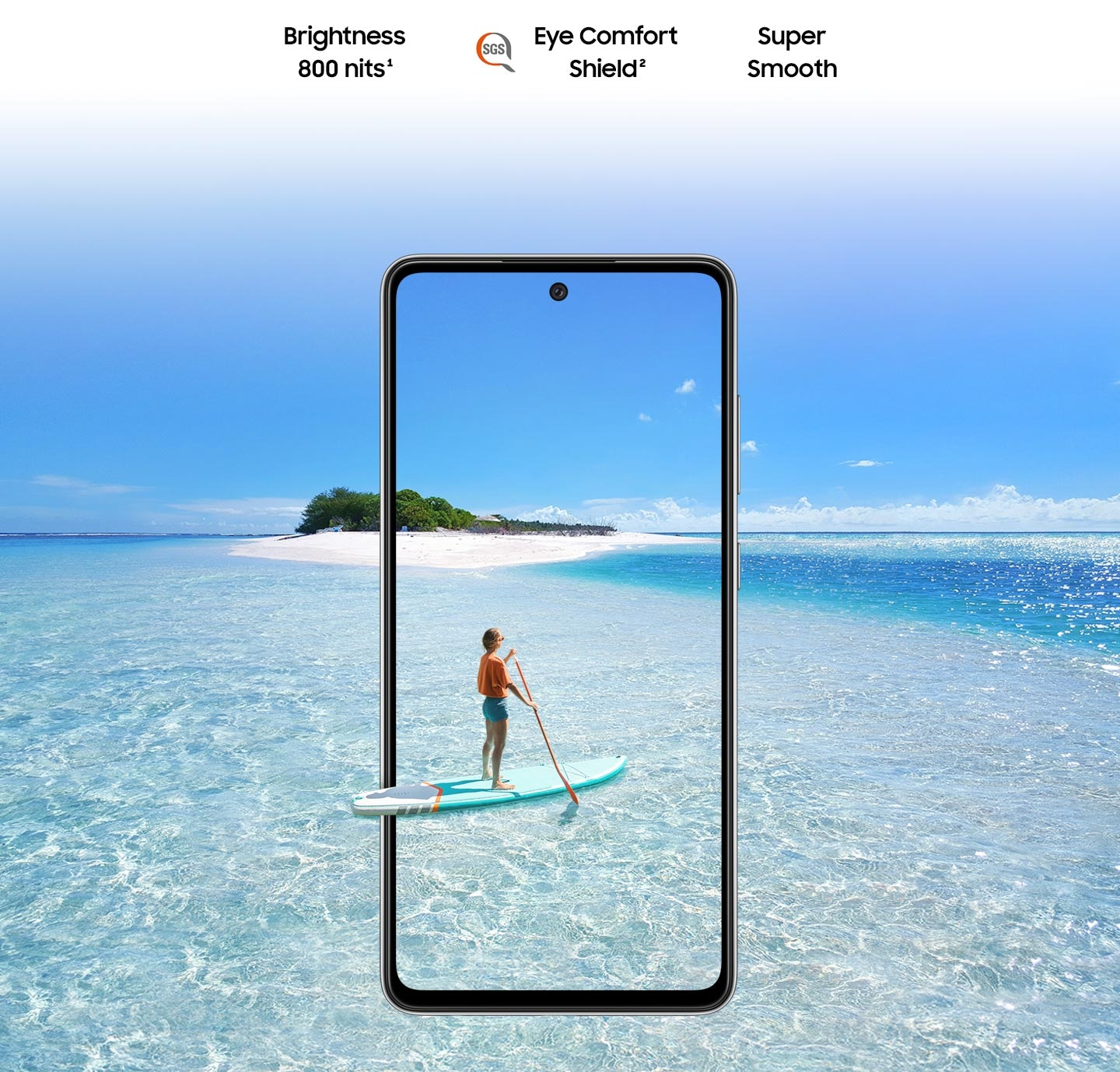 Galaxy A52s 5G seen from the front. Behind the phone and inside the display is a scene of a body of water and a small island. On the phone's screen is a person paddleboarding, and their paddleboard extends slightly outside the boundaries of the phone to represent the screen's immersive view. Text says Super Smooth, Brightness 800 nits and Eye Comfort Shield, with the SGS logo.