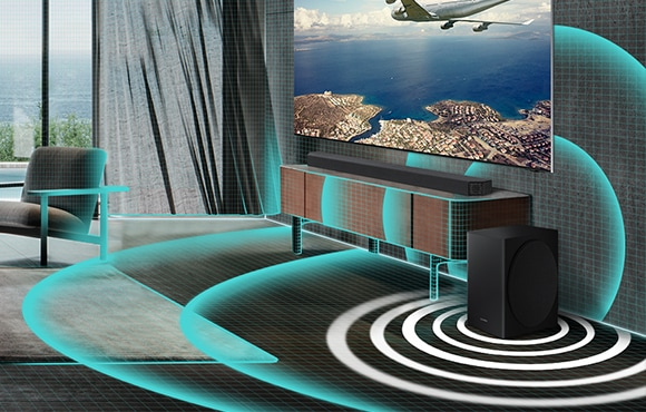 Closeup of soundbar and subwoofer in living room are shown. A grid graphic covers the living room and thickly drawn sound wave graphics are shown beneath the subwoofer to illustrate that Auto EQ is automatically filling the room with powerful bass.